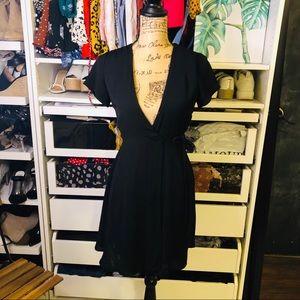 Wrap around black mini dress